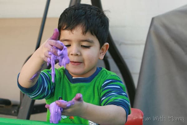 boy playing with slime