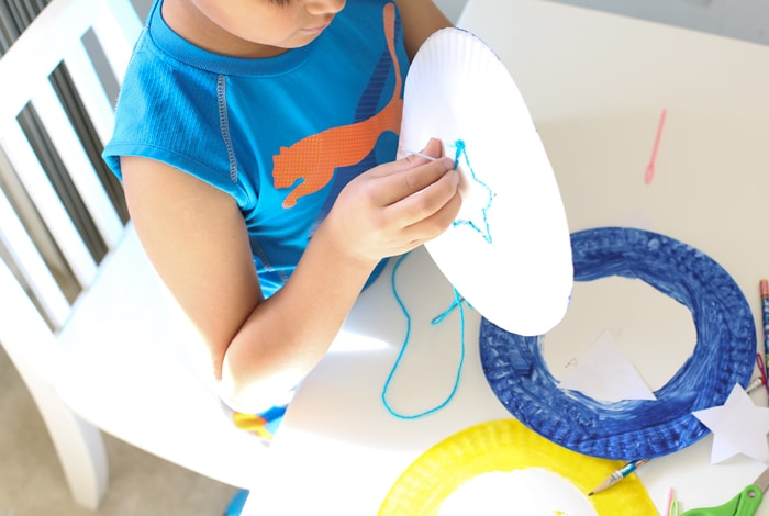 star shaped kids activity that works on fine motor control and weaving