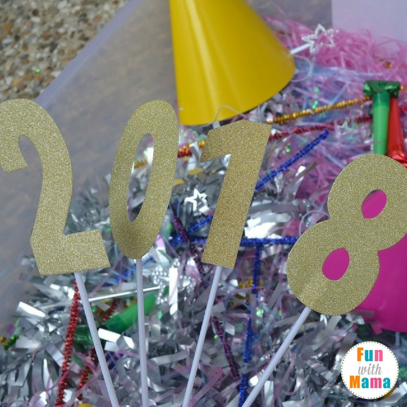 New Year's Eve sensory bin playing 1