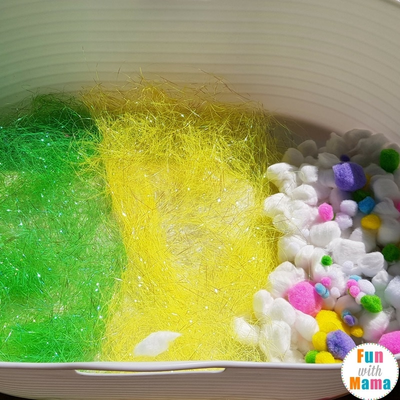 easter sensory bin setting up