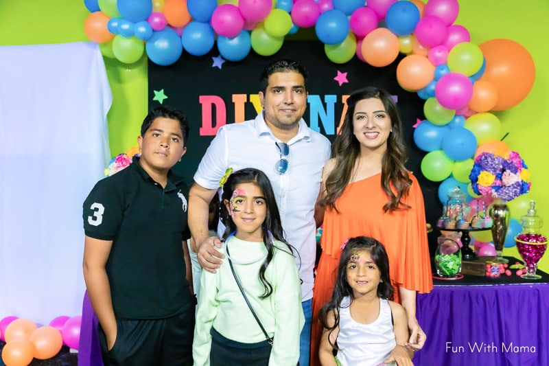 family at neon birthday party