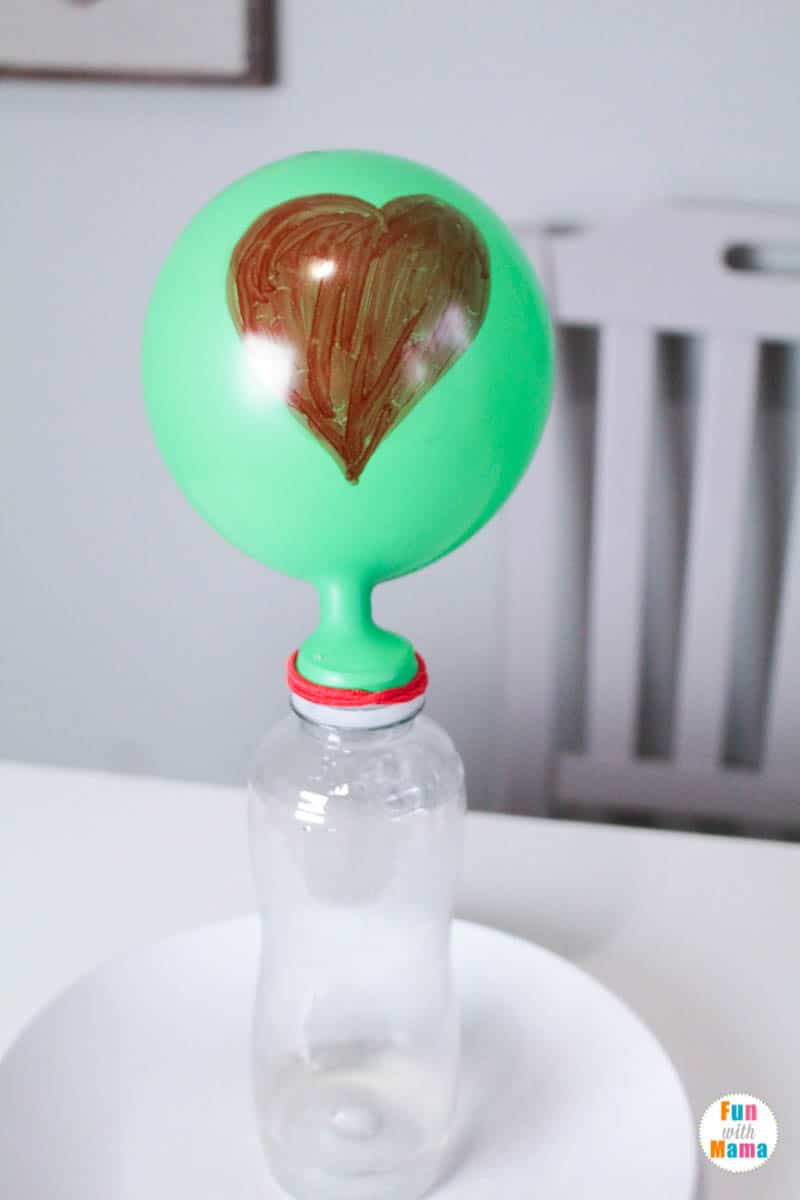 grinch heart science experiment with balloon
