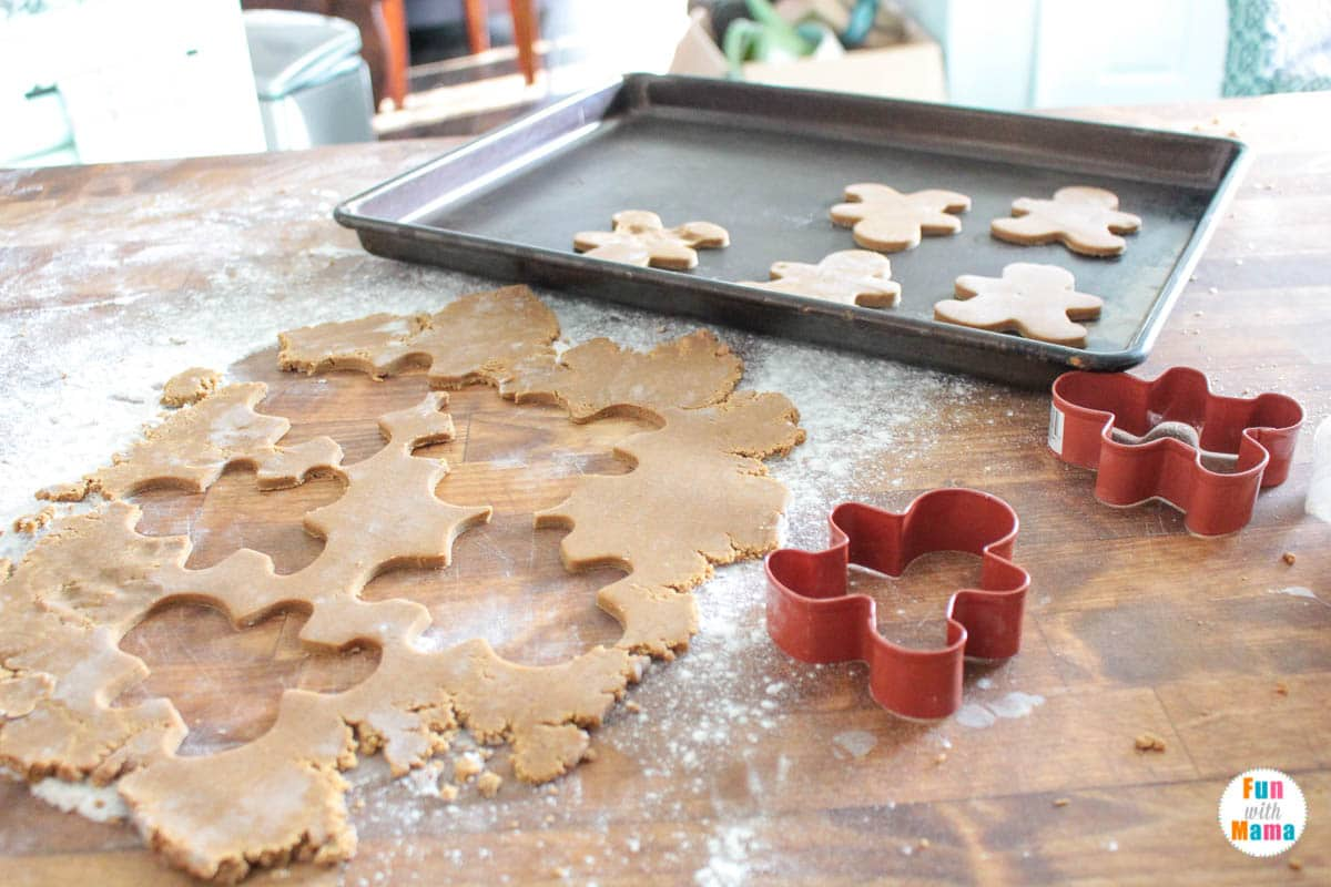using gingerbread cookie cutters to cut out the cookies