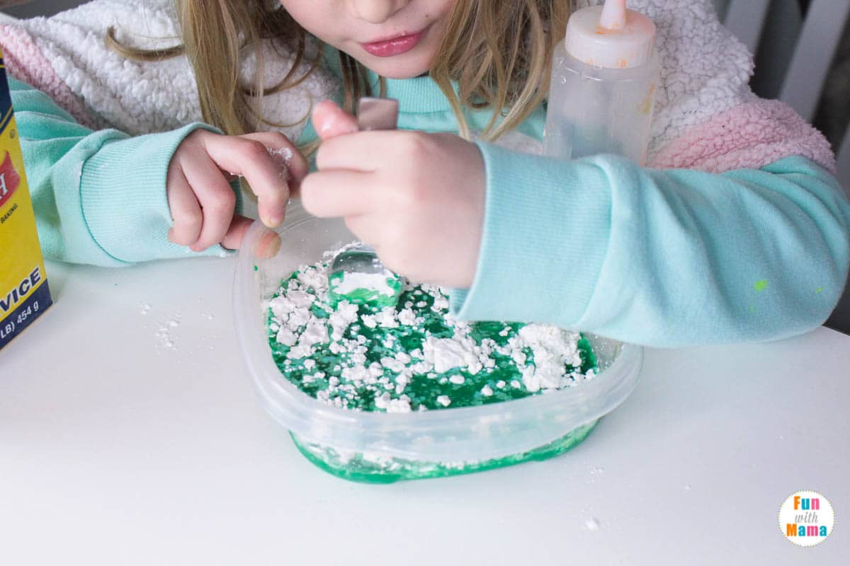 stirring together the ingredients in this oobleck recipe