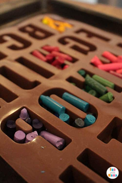 adding crayons to mold