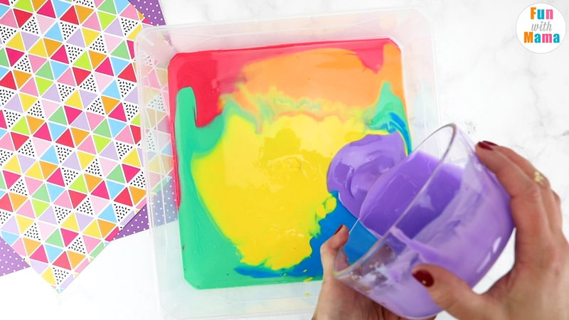 mixing together ingredients for rainbow oobleck