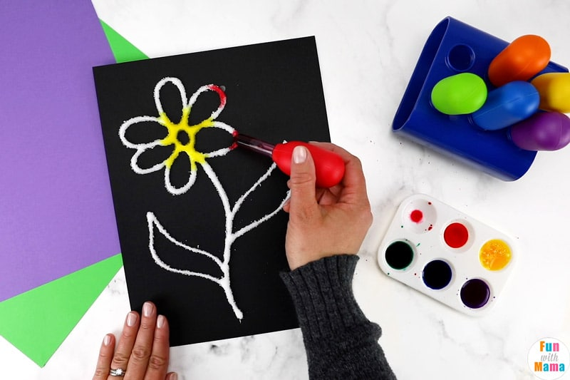 adding paint to the glue flower